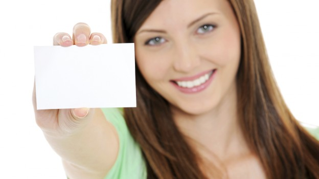 High angle view of happy woman showing the blank bussiness card in hand